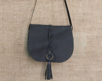 Brown suede crossbody bag with braid and tassel
