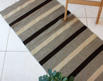 Striped handwoven wool rug in natural white, beige and brown colors, handmade boho rug