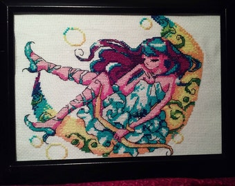 Lady in the moon cross stitch.