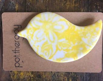 Yellow porcelain bird brooch