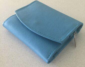 Womens Leather purse wallet.Coin and note sections,press stud, fully lined and compact.Lots of room for cards and coins.Available in colours
