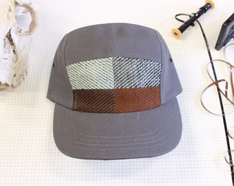 Cassette tape 5 panel. Camp hat with music woven in.