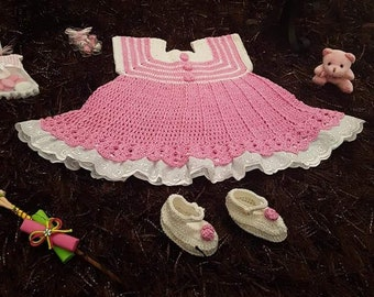 Pink and white crochet baby dress outfit.