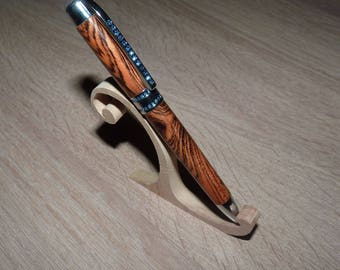 Wood roller in bocotte with blue rhinestones