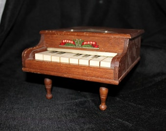 Toy Grand Piano L.H.& C. Inc.
