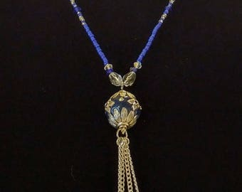 Blue beaded necklace with tassel