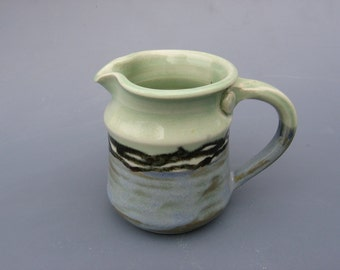 Charming mint green and blue pitcher on sale