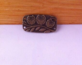 2 rectangle connectors bronze decor 3 owls on a branch 4 attachment holes