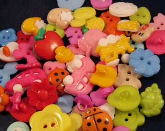 set of 50 plastic craft buttons plastic buttons. handcrafted. apply to sew