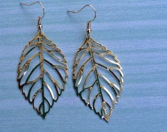 Large gold leaf dangle earrings