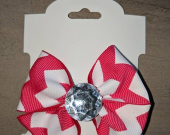 Small, pink and white hairbow on a clip