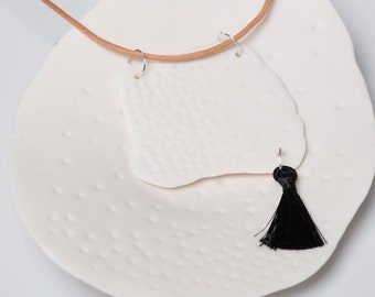 embossed porcelain pendant with a black tassel, one of a kind necklace, unique pottery