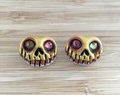 Golden skull earrings, Gr...