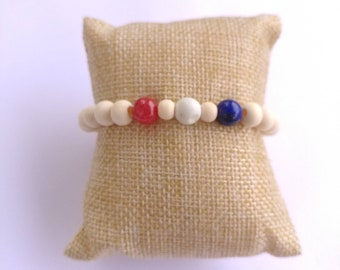 Americana beaded wooden bracelet featuring red quartzite, white howlite and Lapis lazuli stones