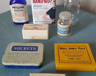 Vintage collection of medical boxes, tins and bottles