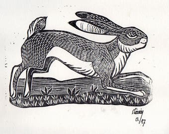 Linocut of a running Hare