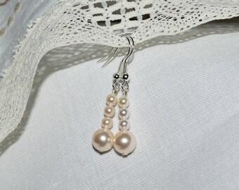 Elegant Silver Plated Swarovski Crystal Pearl drop earrings.