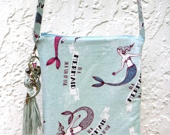 Mermaid-print crossbody bag with tassel keychain purse charm. Be a mermaid in a sea of fish! Fun, whimsical sea life zippered pouch.