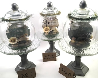 choice glass cloche apothecary globe on stand with religious plaque, bird, flower & charms