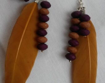 Lovely ochreous feather earrings with a beads, dangling earrings