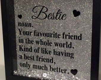 Bestie noun. Your favourite friend in the whole world. Kind of like having a best friend, only much better, black frame with silver glitter.