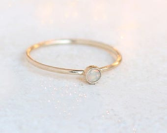 SOLID 14k gold opal ring. ONE delicate stackable birthstone ring. mothers ring. engagement ring.