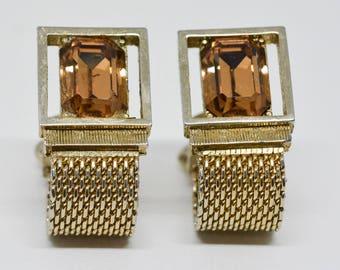 Gold tone cuff links