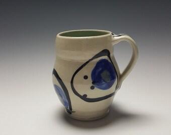 Handmade ceramic mug with blue and black brushstrokes by Potteryi