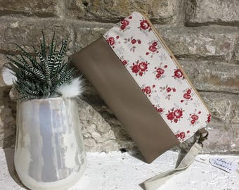 Leather clutch bag with red flowers