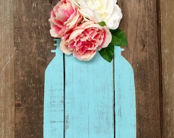 Aqua blue jar and flower wall decor