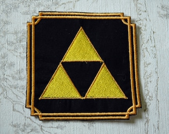 The  Legend of Zelda Triforce embroidered iron on patch.