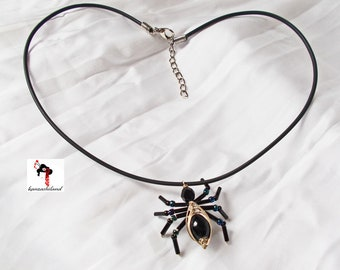 Handmade spider pendant with bead and silver wire with rubber cord.