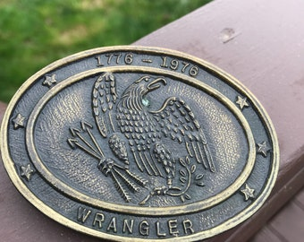 2 Vintage Belt buckle one 1976 Wrangler and one 1996 Siskiyou