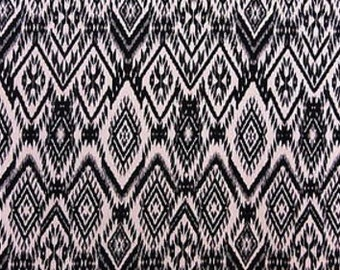 100% Rayon Ivory background w/ Black / Black Diamond Print. Fabric by the yard