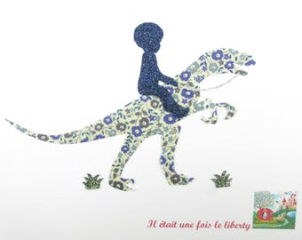 Applied fusible boy on the back of a velociraptor liberty Fairford blue and flex sequined applique liberty collection
