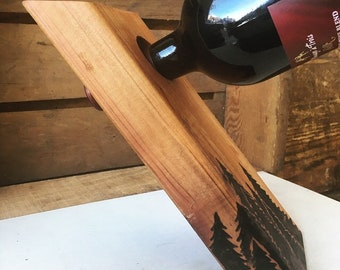 Self-balancing Wine Holder | handmade, woodburned, gift, wine bottle stand, pines