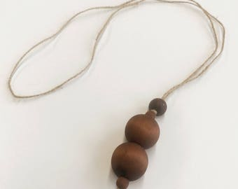 Hemp necklace with hand-dyed wooden beads