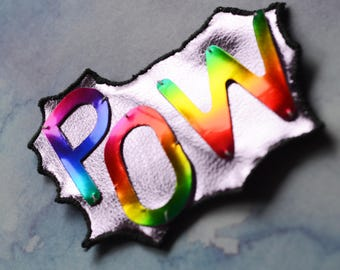 Embroidered 'POW' patch. Pop art sew-on applique patch with metallic and shiny vegan pink leatherette and rainbow vinyl