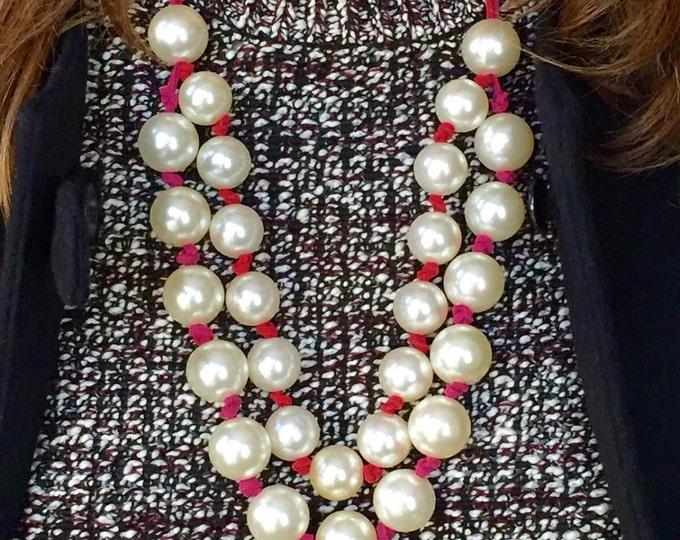 White beaded statement necklace with red and pink  color laces