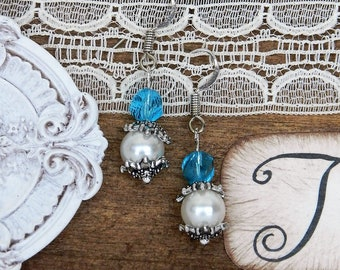 White and blue beaded earrings.