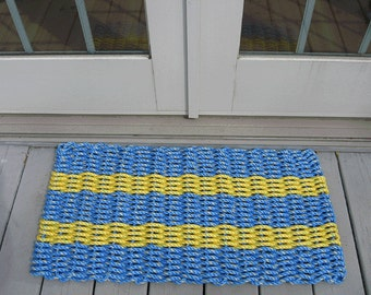 Blue and Yellow handwoven doormat from lobster trap rope.