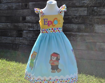 Deluxe Epcot International Duffy Bear Huckleberry Dress.  2yrs-10yrs.  By Hoot n Hollar Childrens Clothing