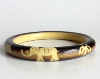 Celluloid Elephant Bangle with Palm Trees - Dark Brown Over Dye on Cream Yellow Bracelet - Vintage 20s Early Plastic - Lucky Animal Figural