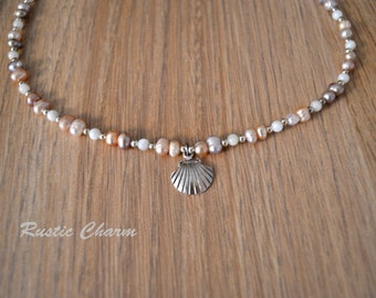 Pink/Lavender Fresh Water Pearl Necklace with Silver Plated Shell Charm