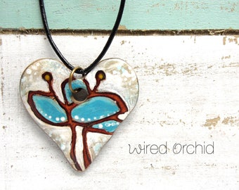 Polymer Clay Heart Pendant Jewelry featuring a Whimsical Floral Design in Blue, Brown and White
