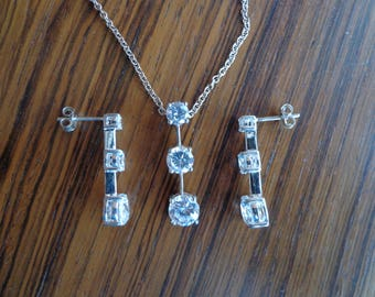 Silver and Cubic Zirconia earrings/pendant with chain.