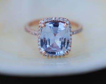 Blue sapphire engagement ring. 14k rose gold ring with GIA certified 5.65ct cushion blue gray sapphire. Engagement ring by Eidelprecious