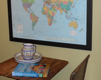 Colorful  Push Pin Travel World Map On A Dark Coffee Brown Frame
