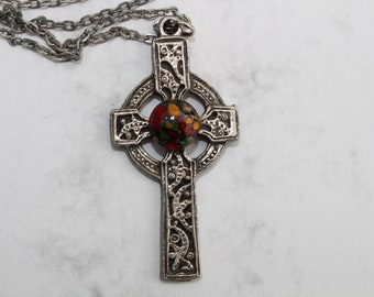 Heathergem cross.  An Iona style cross on a chain set in the middle with a synthetic stone made from real Scottish heather.