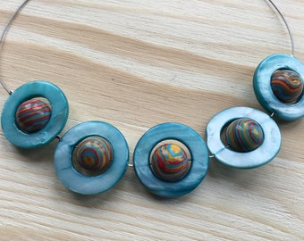 Necklace with Mother of Pearl Rings with 'Planet' beads